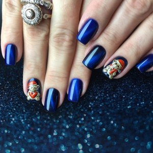 Beautiful blue nail art design with 3d bears