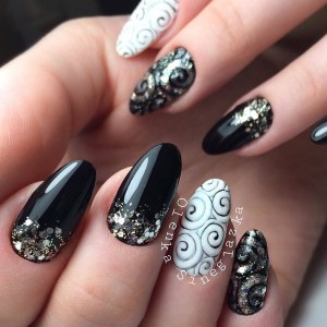 Black and white nail polish design with glitter