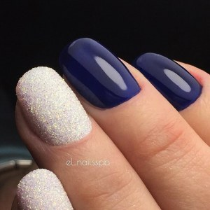 Blue and white manicure with glitter