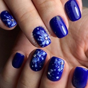 blue manicure nail art idea with snowflakes