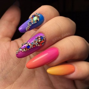 Bright gradient manicure with crystals and microbeads