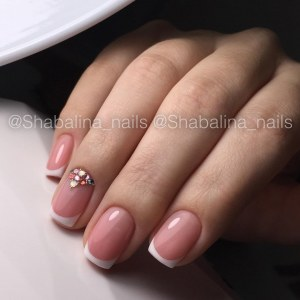 Classic white french manicure nails with rhinestones and caviar beads