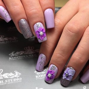 Lilac manicure nail design idea with 3D flower