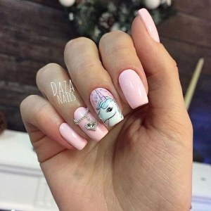 Pink manicure nail art with unicorn