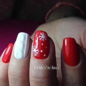Red winter manicure nail design idea with snowflakes and sweater