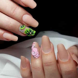 Skin color cool manicure nail art idea with 3d flowers