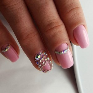 Soft pink manicure with rhinestones and microbeads