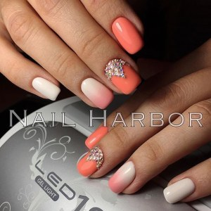 White and coral manicure idea with rhinestones