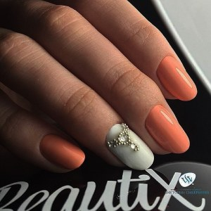 White and coral manicure nail design idea with caviar beds and swarowski crystals